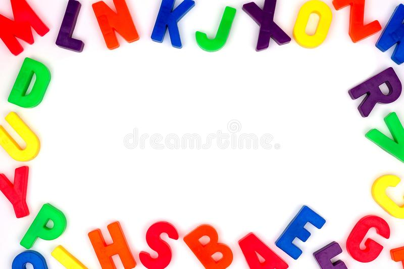 Toy magnetic alphabet letter frame over white royalty free stock image