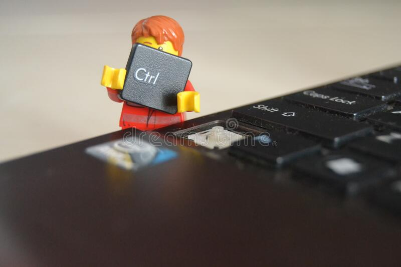 Toy man removing computer key stock images