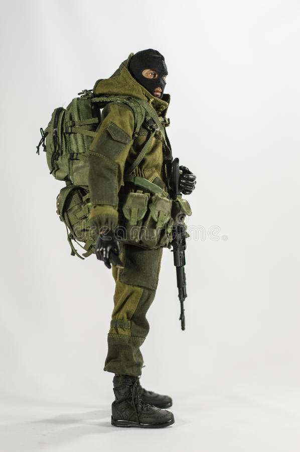 Toy man 1/6 scale soldier action figure army miniature realistic white background royalty free stock images
