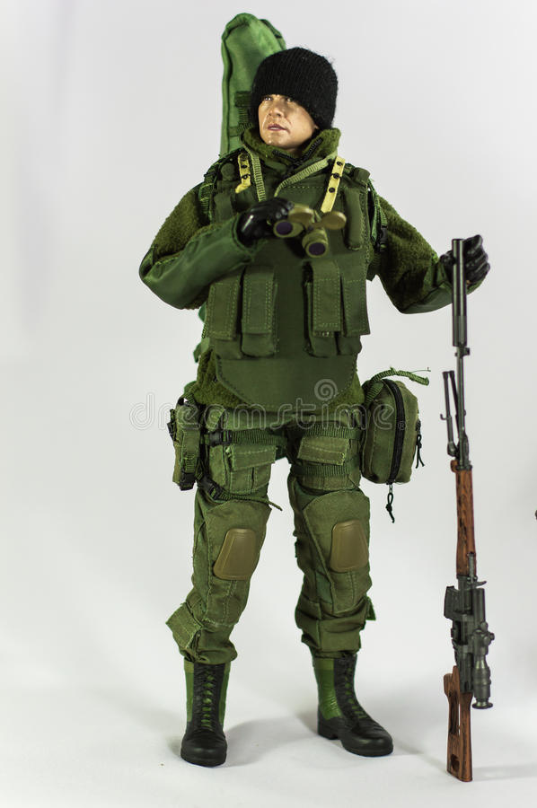 Toy man soldier action figure miniature realistic silk white background. Toy army and soldier 1/6 scale action figure miniature realistic silk green spetsnaz stock photography