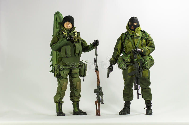 Toy man soldier action figure miniature realistic silk white background. Isolated toy army and soldier 1/6 scale action figure miniature realistic silk green royalty free stock image