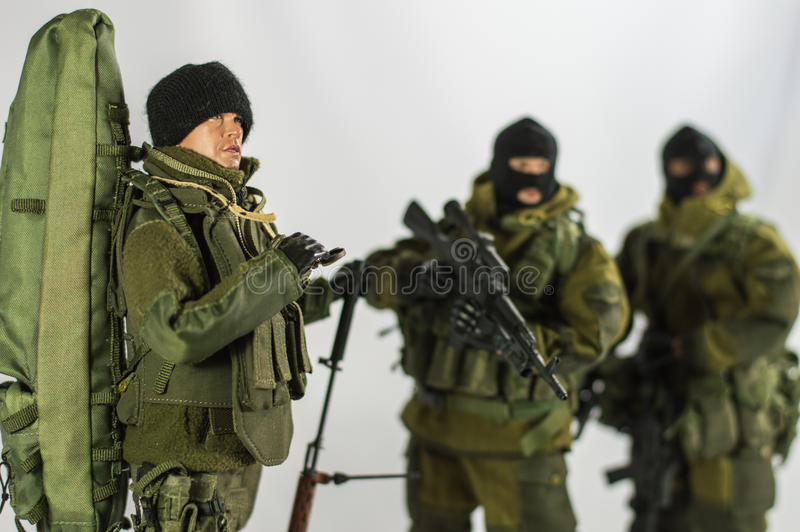 Toy man soldier action figure miniature realistic silk white background. Toy soldier 1/6 scale action figure miniature realistic silk army and military stock photos