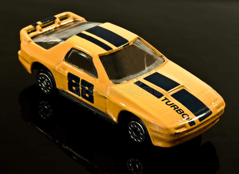 Toy racing car. A metal model toy racing car on black background royalty free stock photos
