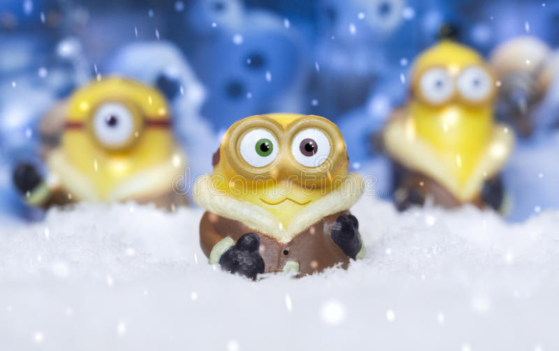 Toy minions in snow royalty free stock photography