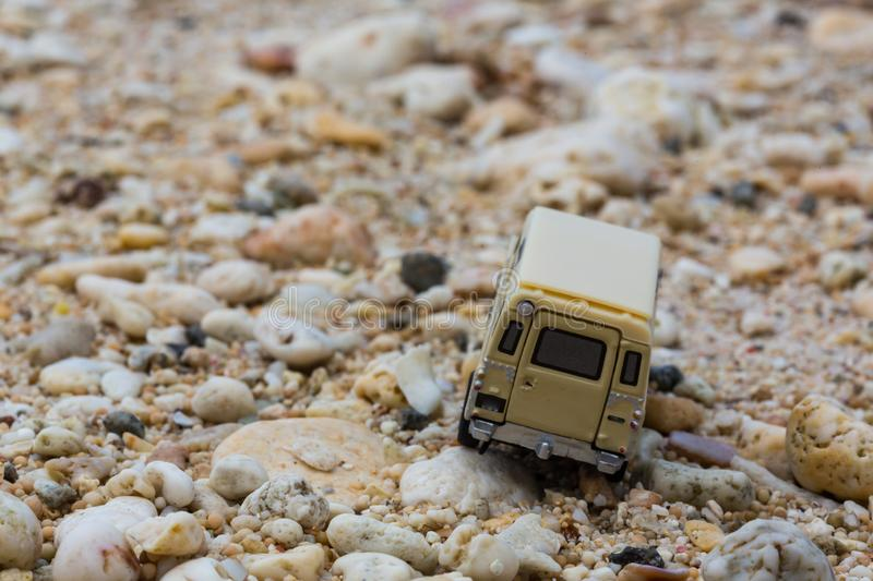 Toy 4x4 Offroad vehicle drives at the beach.  royalty free stock photo
