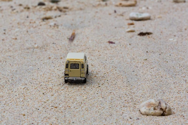 Toy 4x4 Offroad vehicle drives at the beach.  royalty free stock image