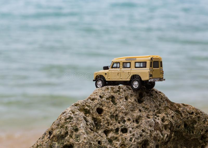 Toy 4x4 Offroad vehicle drives at the beach.  royalty free stock images