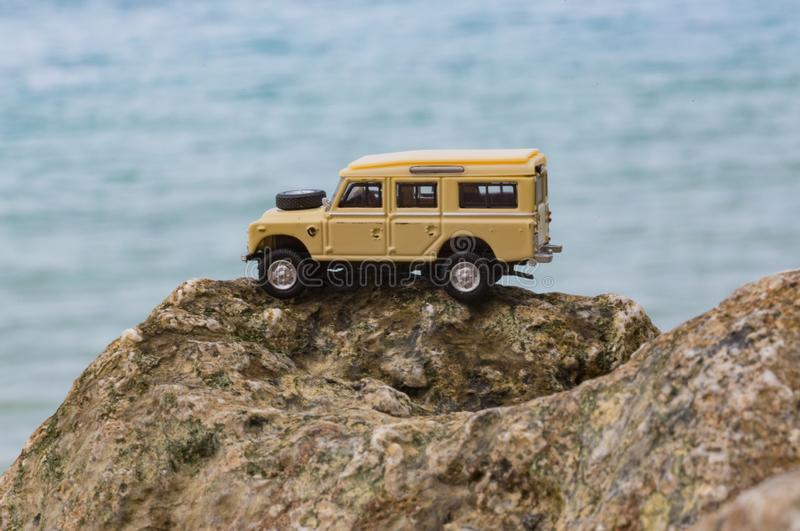 Toy 4x4 Offroad vehicle drives at the beach.  stock photography