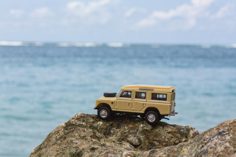 Toy 4x4 Offroad vehicle drives at the beach.  stock image