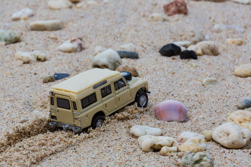 Toy 4x4 Offroad vehicle drives at the beach.  royalty free stock photos