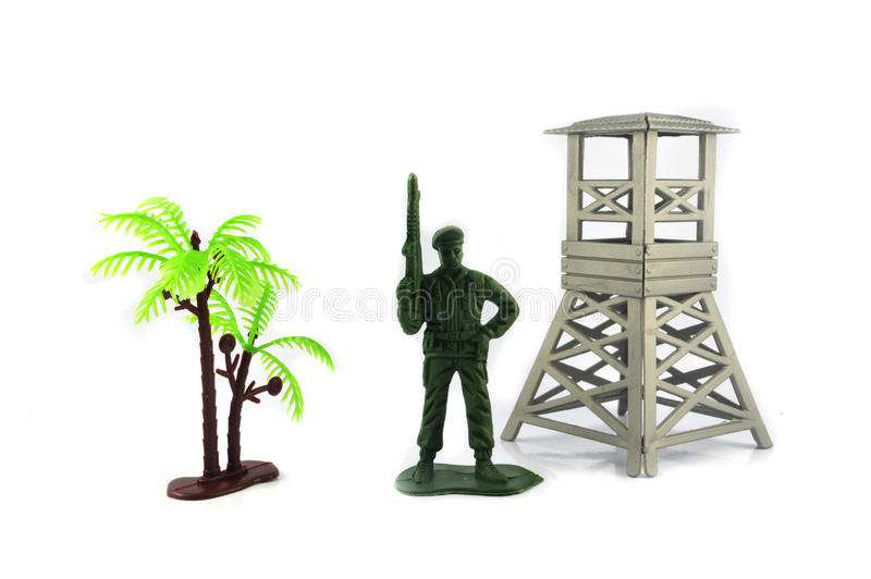 Toy one soldier and military base. White background stock images
