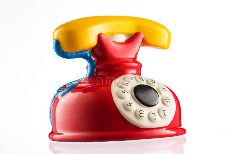 Toy Phone på vit bakgrund arkivfoto