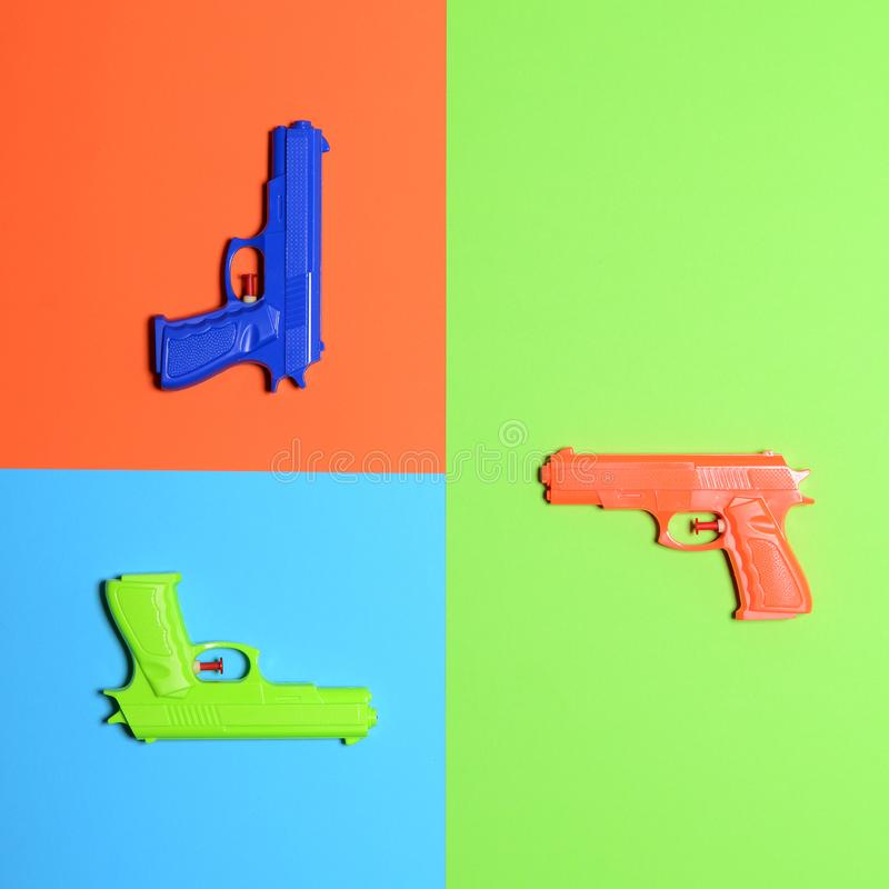 Free Toy Pistols On Colorful Background  - Minimal Design Top View Royalty Free Stock Images - 146710979