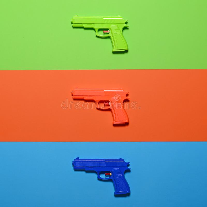 Free Toy Pistols On Colorful Background  - Minimal Design Top View Stock Photography - 146711032