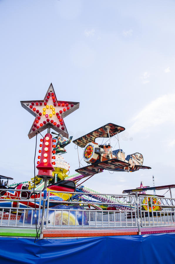 Toy plane carousel in amusement park royalty free stock photography