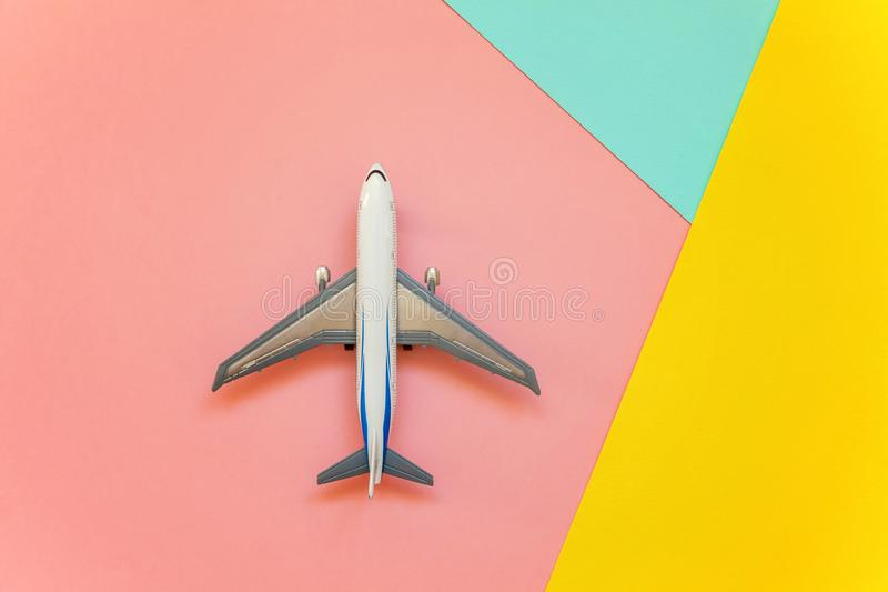 Toy plane on a colored background royalty free stock image