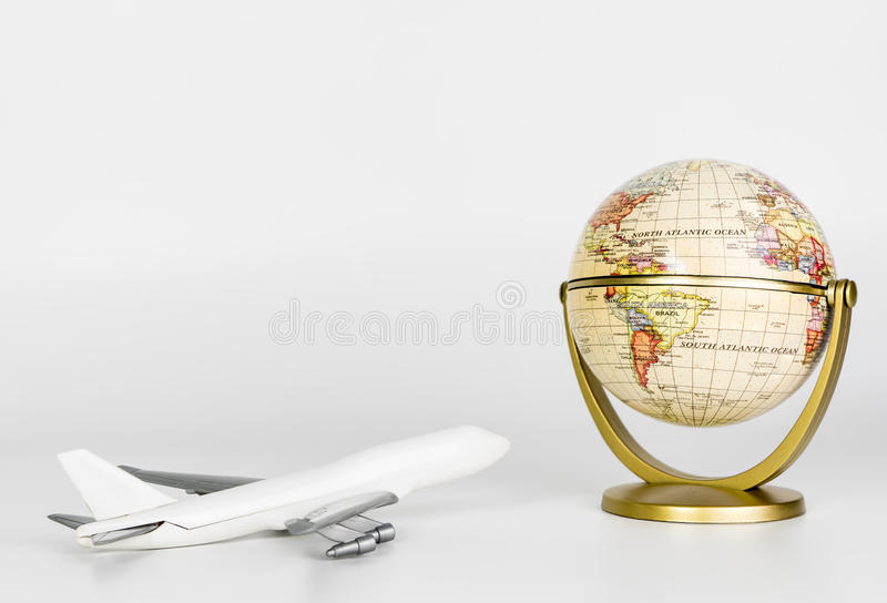 Toy plane flying to the Earth royalty free stock photography