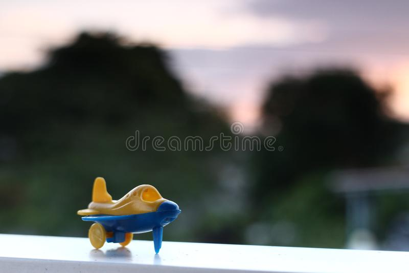 A toy plane on a runaway. A toy airplane on a runaway with sunset background royalty free stock photography