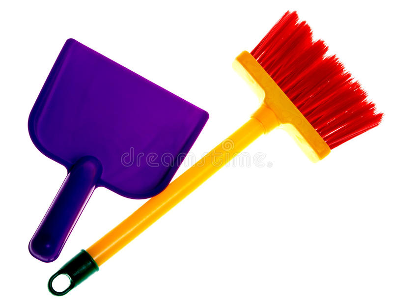 Toy plastic dustpan and broom royalty free stock image