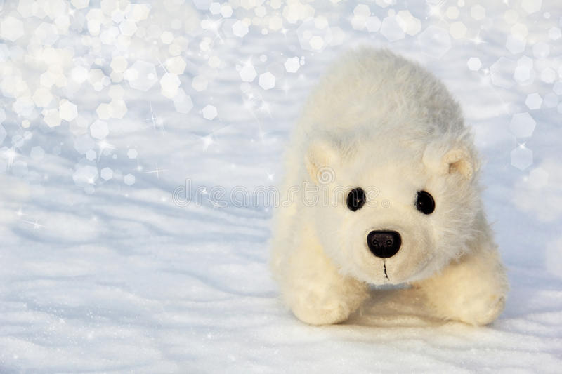 Toy polar bear cub in the Arctic. Wilderness stock photo