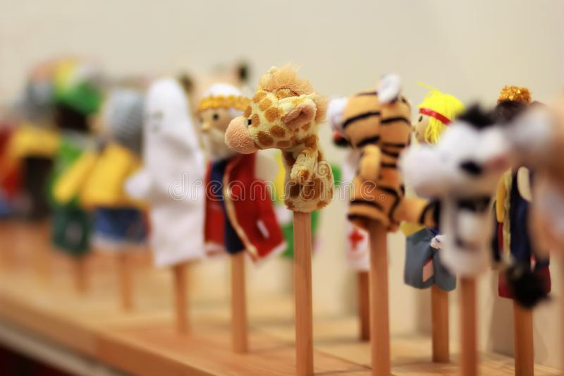 Toy puppets on wooden sticks for preschool nursery theatre, standing in a row. Puppet theatre. Toy puppets on wooden sticks for preschool nursery theatre stock photos
