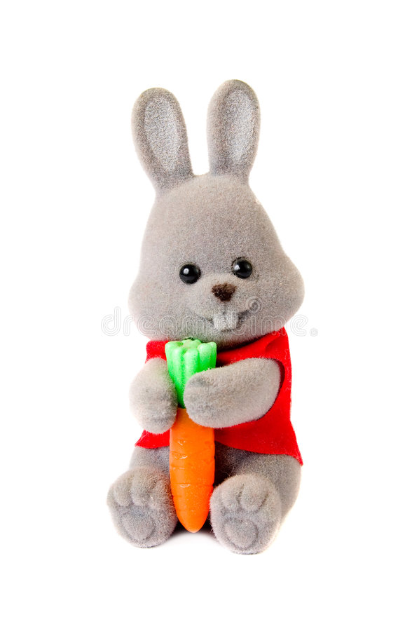 Toy rabbit with carrot isolated on white royalty free stock photo