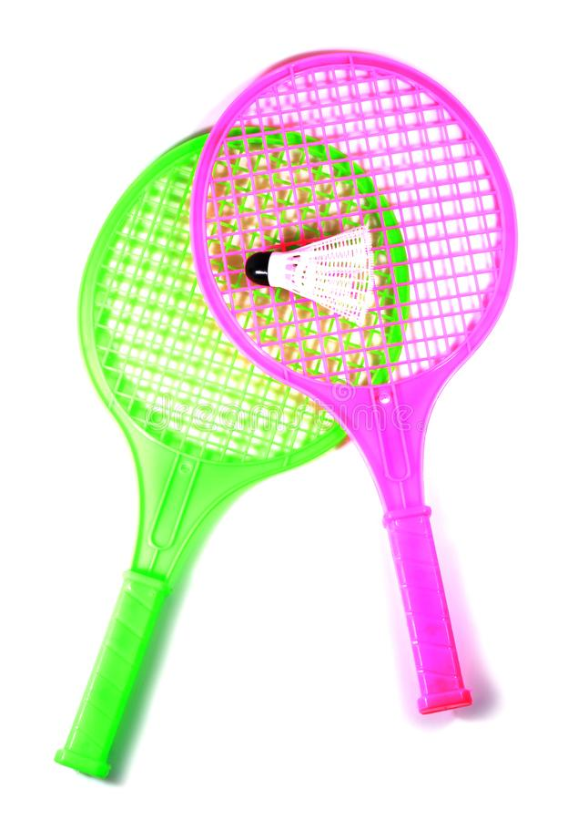 Toy racket with shuttlecock ball. Two plastic toy rackets and shuttlecock ball with isolated white background royalty free stock photos