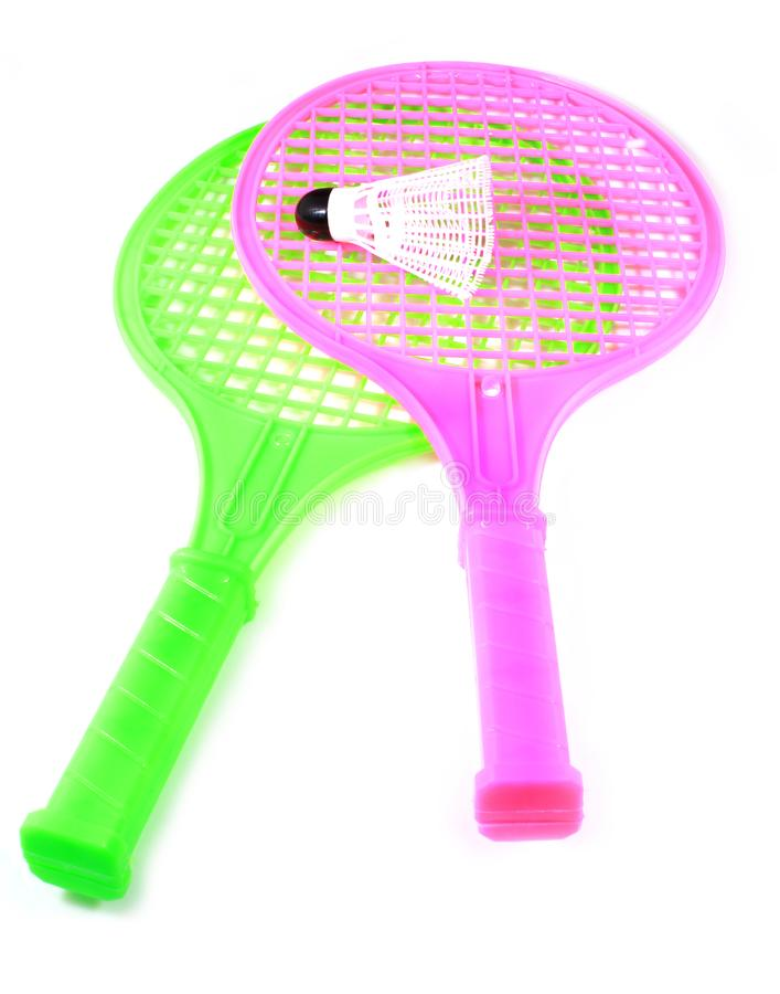 Toy racket with shuttlecock ball. Two plastic toy rackets and shuttlecock ball with isolated white background royalty free stock images