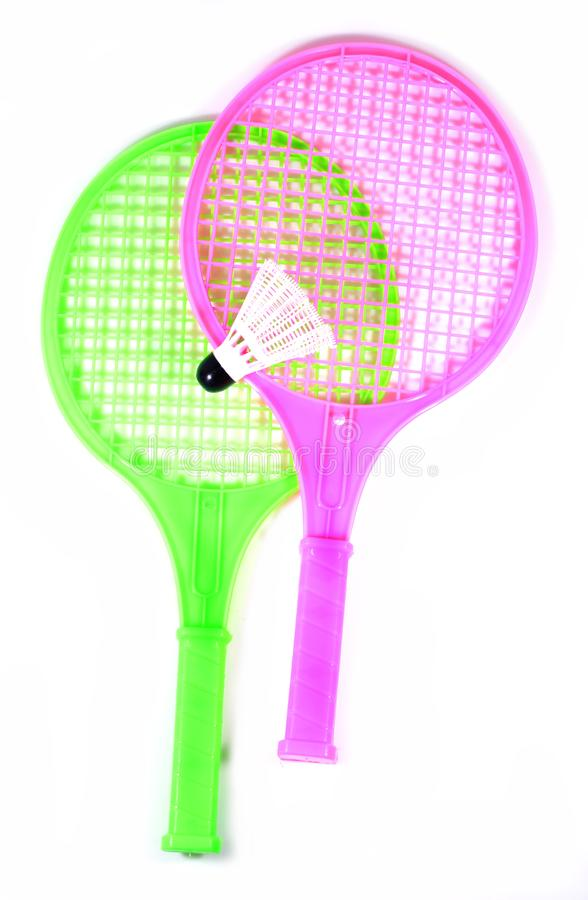Toy racket with shuttlecock ball. Two plastic toy rackets and shuttlecock ball with isolated white background stock image