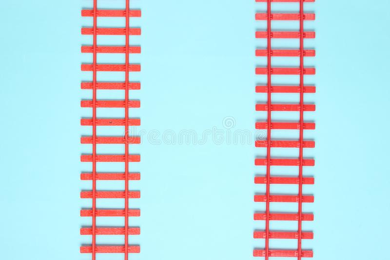 Toy railroad tracks on blue pastel background. Top View. Toy railroad tracks on blue pastel background. Top View stock image