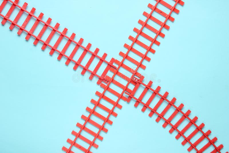 Toy railroad tracks on blue pastel background. Top View. Toy railroad tracks on blue pastel background. Top View stock photos