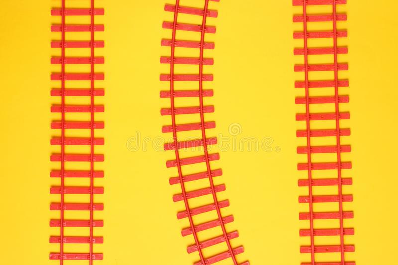 Toy railroad tracks on yellow pastel background. Top View. Toy railroad tracks on yellow pastel background. Top View royalty free stock images