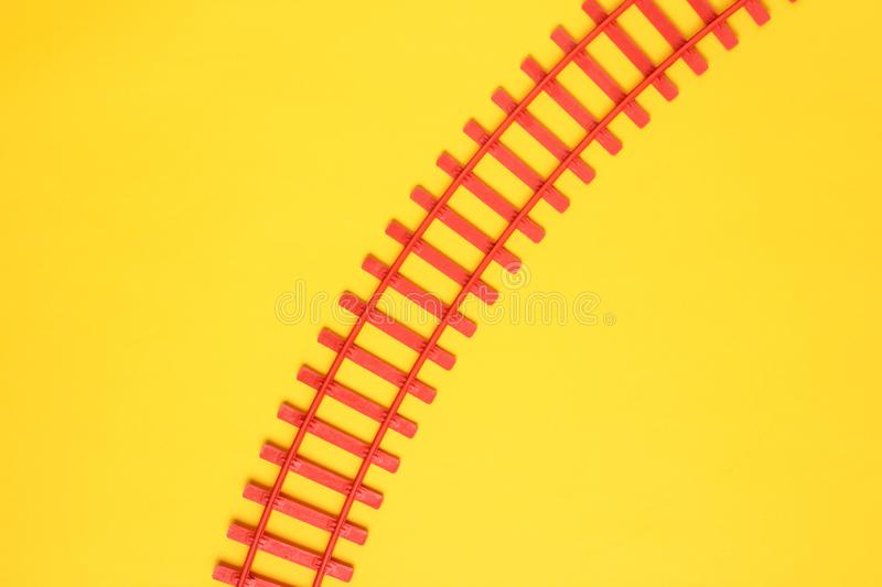 Toy railroad tracks on yellow pastel background. Top View. Toy railroad tracks on yellow pastel background. Top View stock images