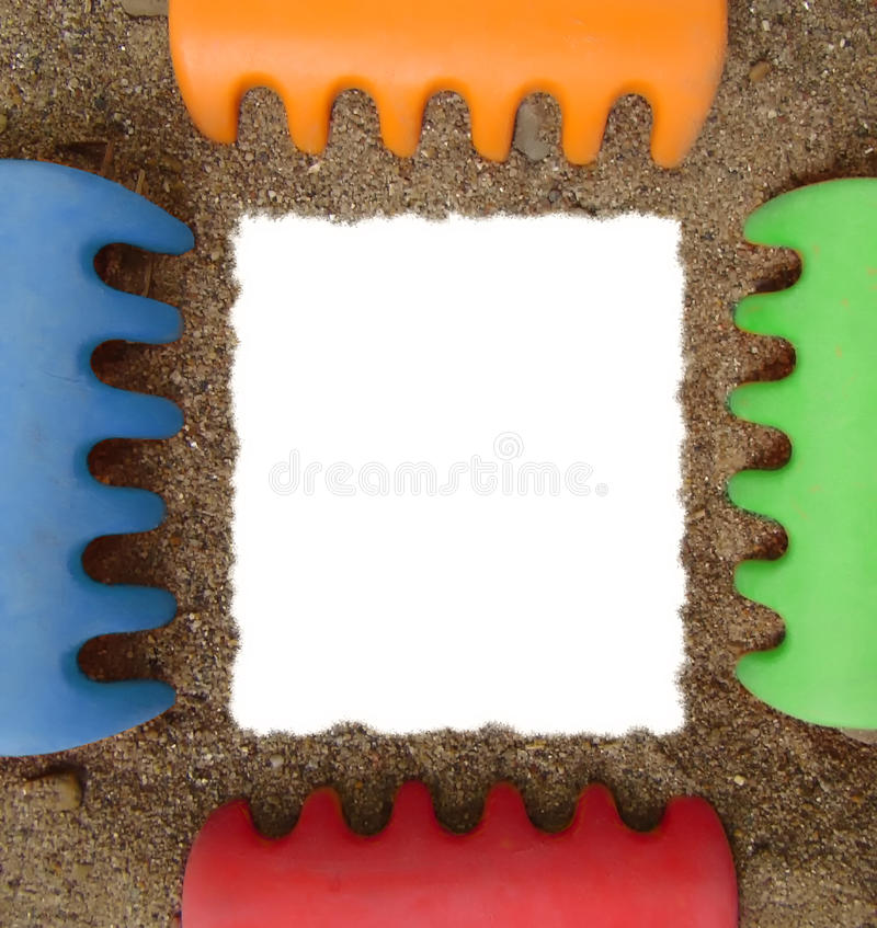 Toy rake and sand photo frame stock photography