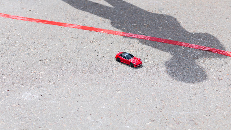 Toy red car outdoors. Small car on the road royalty free stock photos