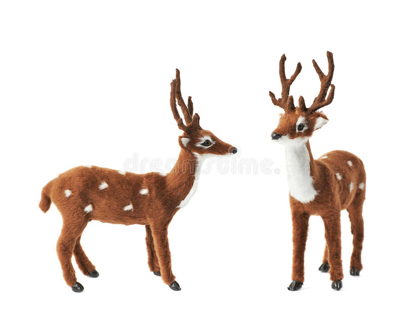 Toy roe deer fawn isolated. Toy roe deer fawn figurine isolated over the white background, set collection of two different foreshortenings royalty free stock photography