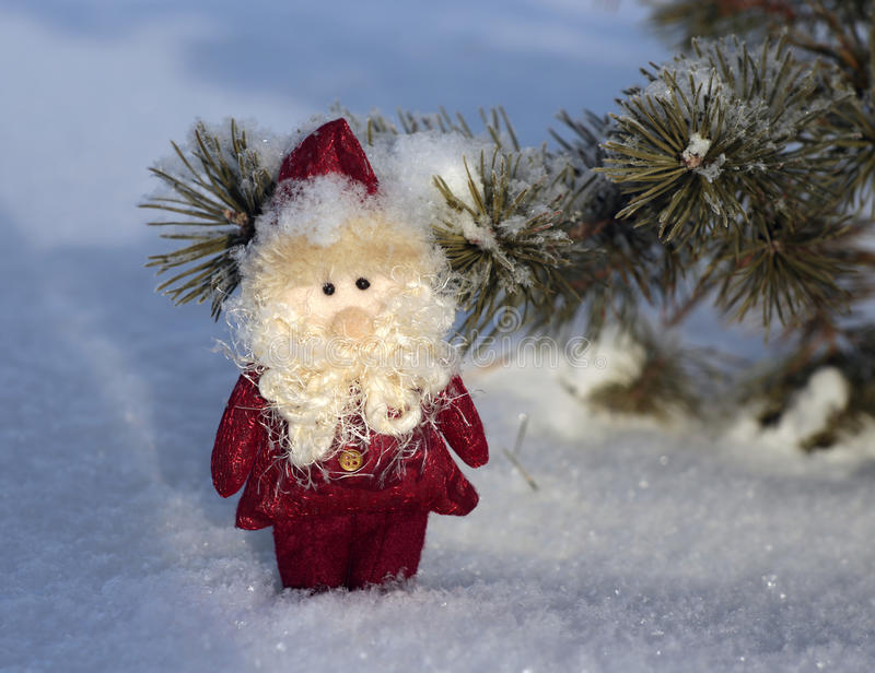 Toy Santa Claus on the snow royalty free stock photo