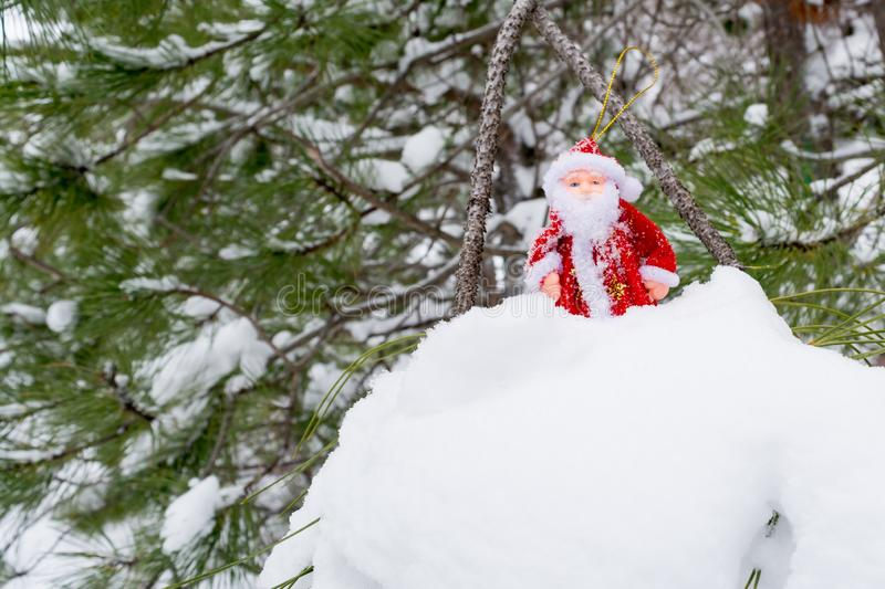 Toy Santa Claus in the snow stock images