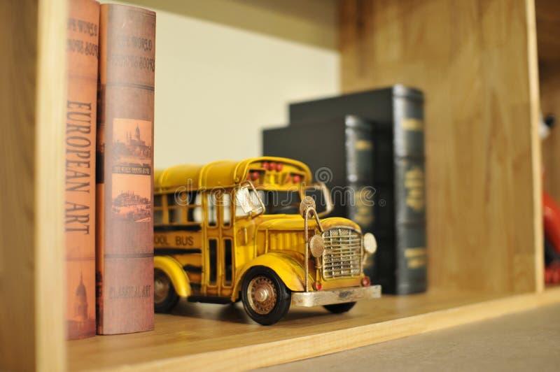 Toy school bus on bookshelf