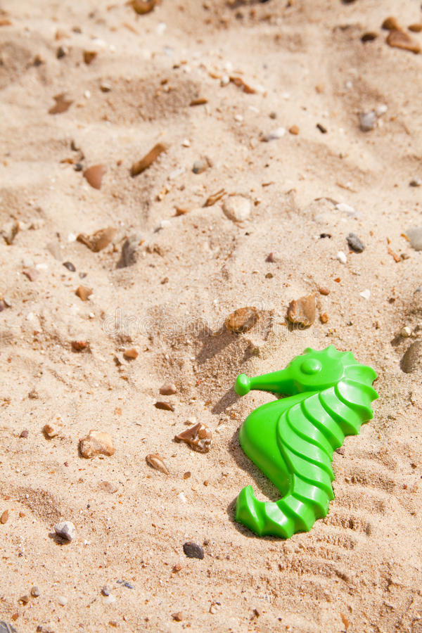 Toy seahorse on the beach