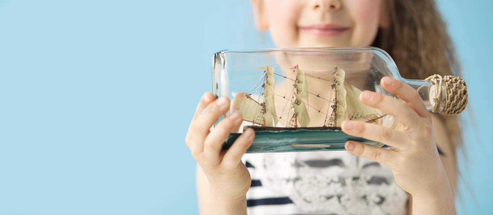 Toy ship in the bottle. Toy ship in the fancy bottle stock photo