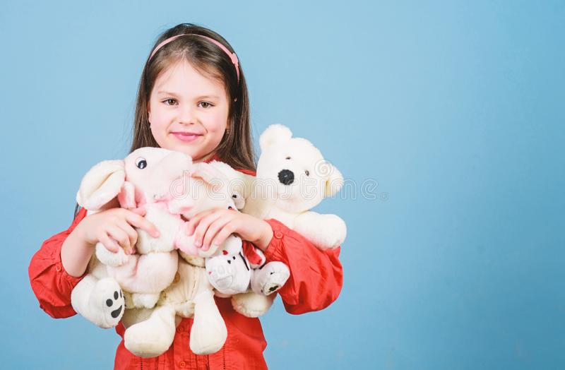 Toy shop. childrens day. Best friend. little girl playing game in playroom. happy childhood. Birthday. hugging a teddy. Bear. small girl with soft bear toy stock photo