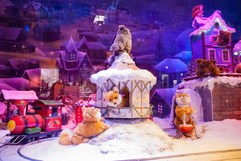 Toy shop display window winter Christmas model train animals royalty free stock photo