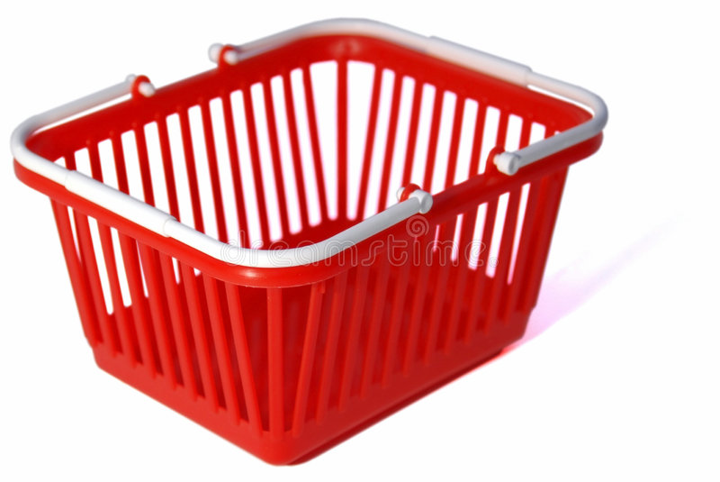 Toy shopping basket. Closeup of a toy shopping basket. Embedded clipping path, although the rear corner is a bit tricky due to being out of focus area