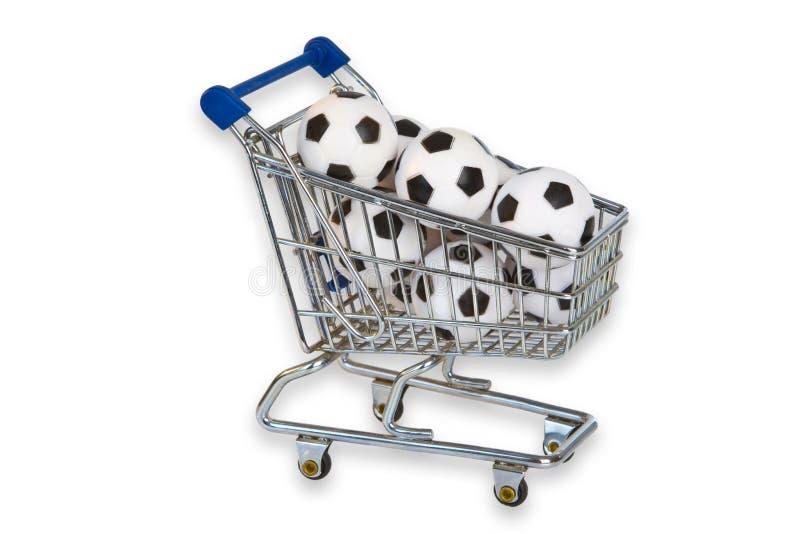 Toy Shopping Trolley med fotbollbollar fotografering för bildbyråer