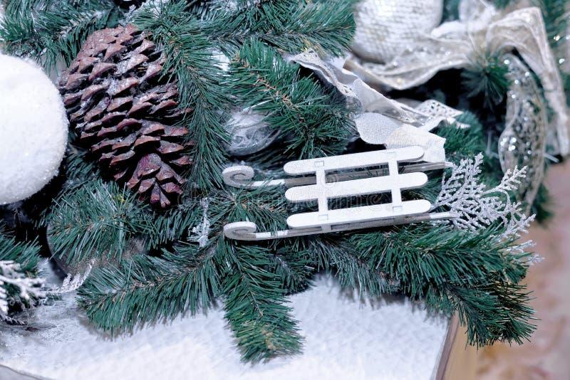 Toy sled,  fir cone and ball hang like Christmas toys stock photo