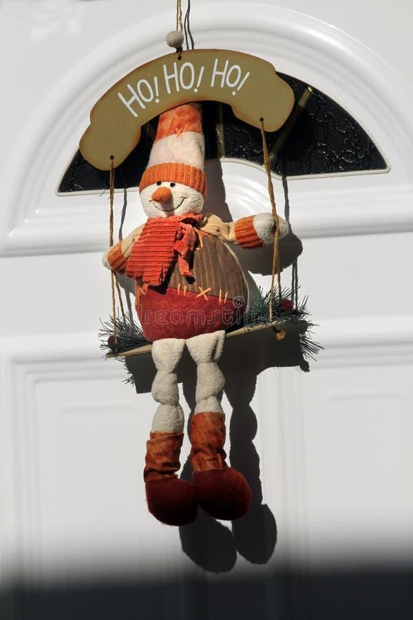 Toy snowman swing Christmas door decoration street gifts sun shade stock photo