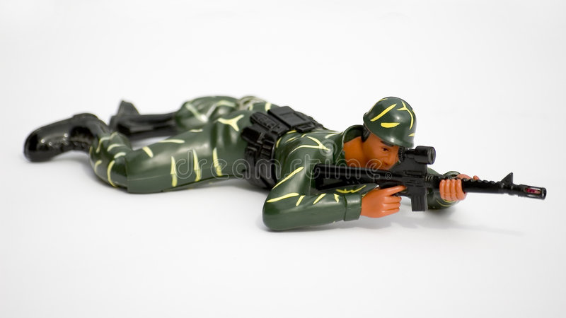 Toy soldier. A toy soldier crawling stock photo