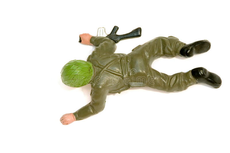 Toy soldier. Crawling on its stomach, holding a rifle stock photo