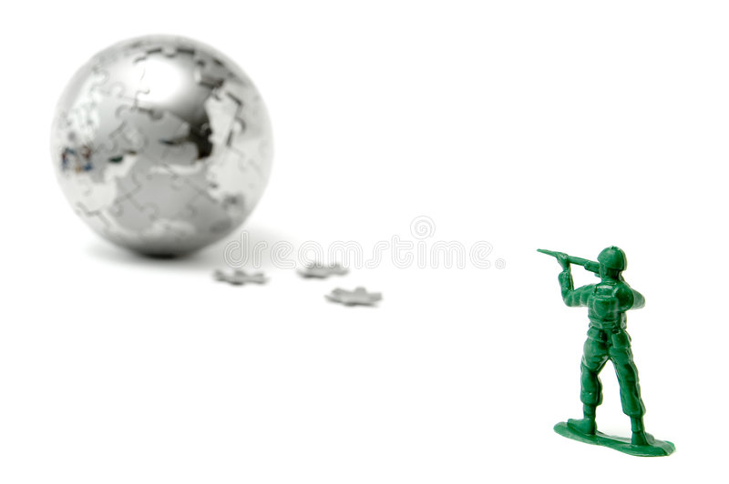 Toy soldier aiming at the world. Toy soldier aiming his rifle at the world royalty free stock images